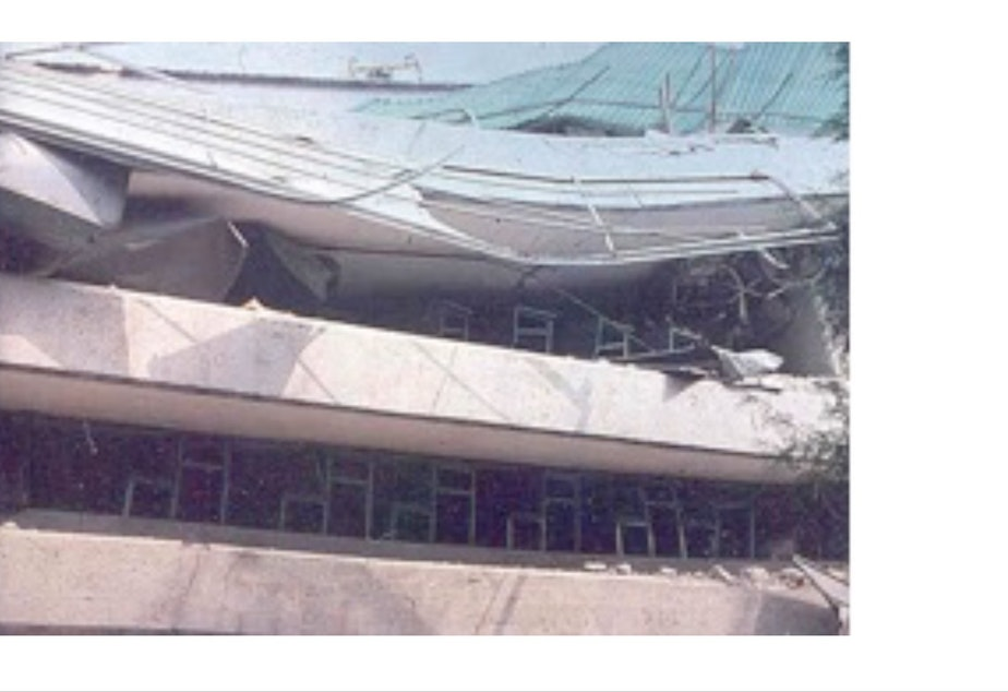 caption: Desks hold up the roof of a building in Mexico in 1985 following an earthquake.
