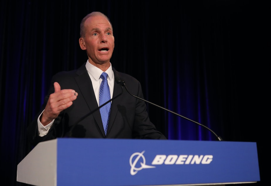 caption: Boeing Chief Executive Officer Dennis Muilenburg speaks at the Boeing Annual Shareholders Meeting on Friday in Chicago.