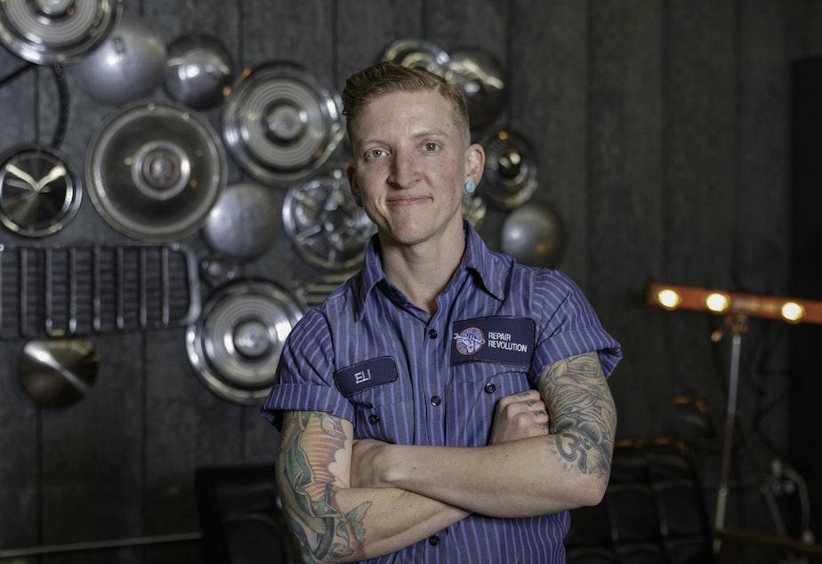 caption: Eli Allison, owner of Repair Revolution auto repair shop in SODO.