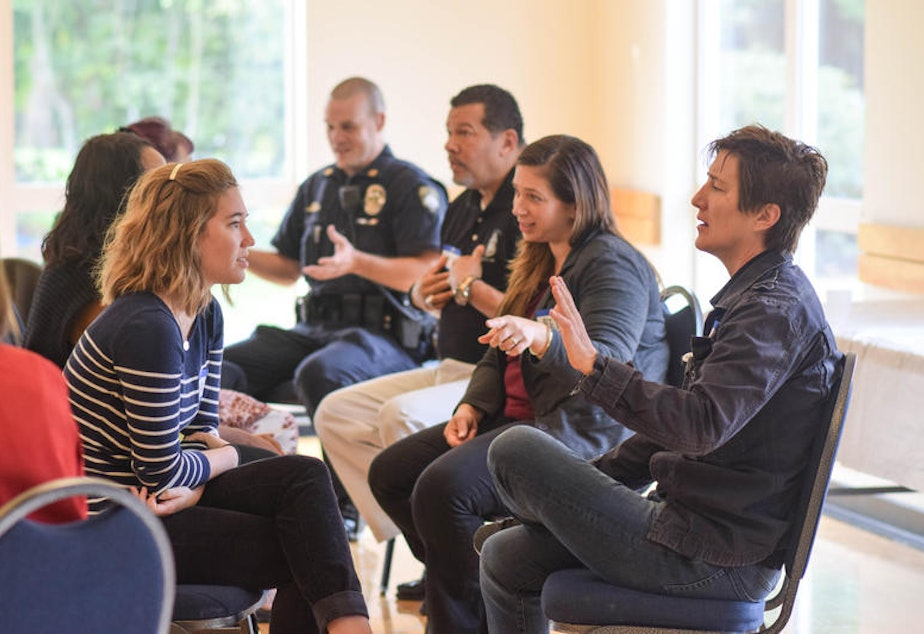 caption: KUOW's Ask A Cop event at the Tukwila Community Center