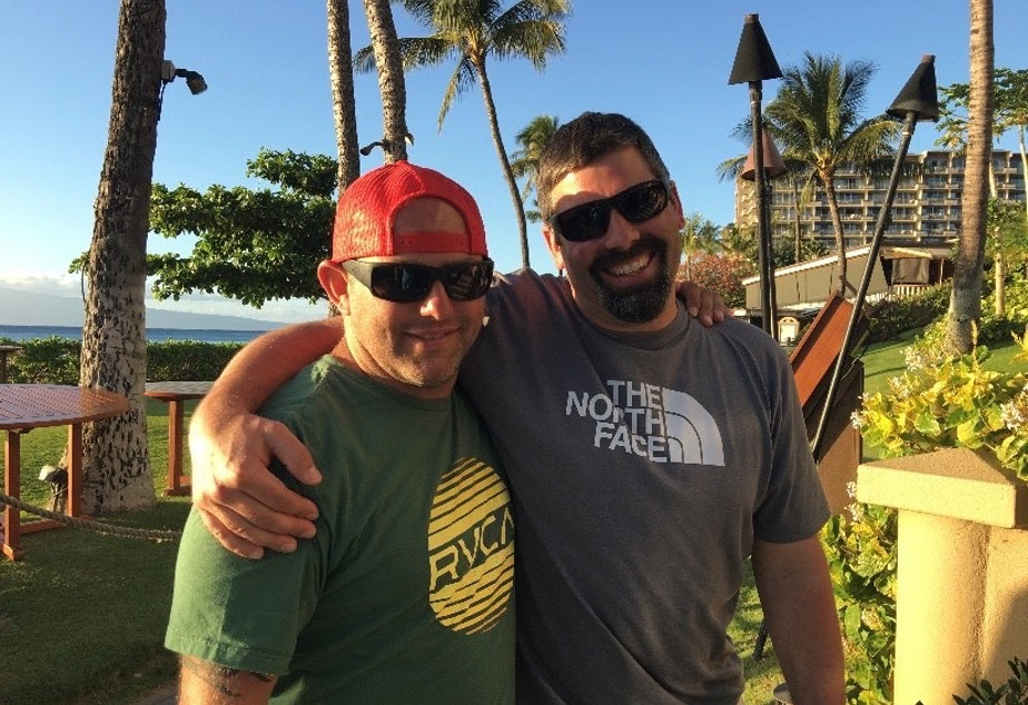 "caption: From 11th grade Oak Harbor High School student, Audrey Lang: ""This is a picture of my dad and godfather in Hawaii in April of 2017. We took this trip as a way of celebrating the time that he had left of being able to move and walk somewhat freely without assistance. I snapped this picture while both of our families were walking down the sidewalk above the beach towards our dinner reservation that night, and my dad and him looked so happy it was the perfect opportunity for a picture."""