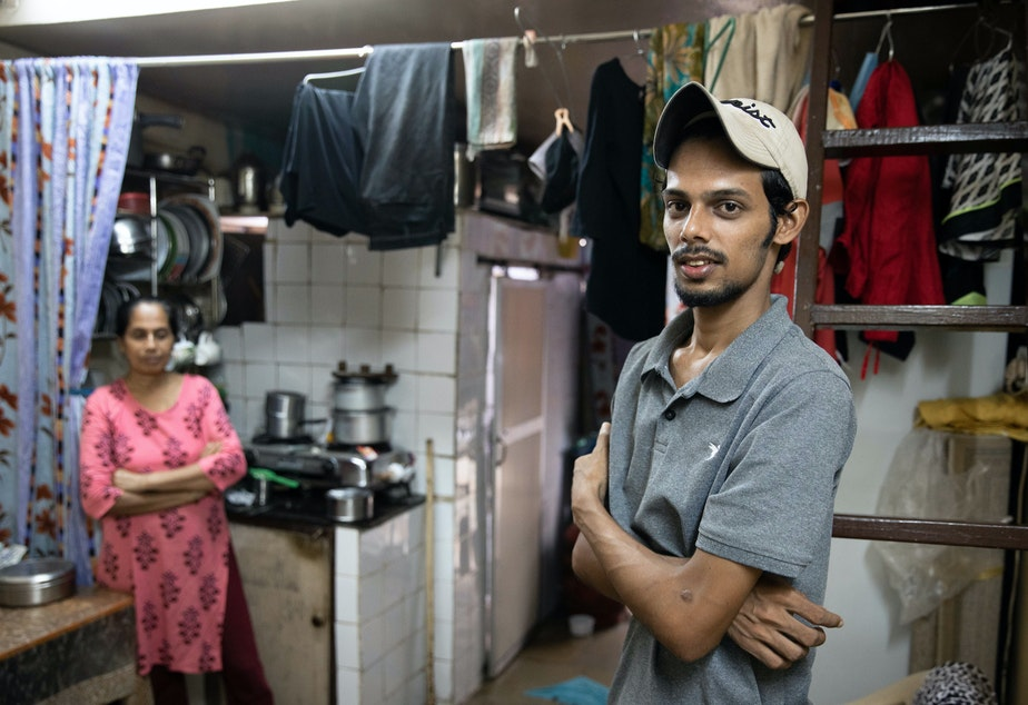 caption: Salman Khan Rashid, 24, right, and his mother, Sana Rashid, at home. Salman lost his job as a golf coach at a Mumbai sports club during the pandemic. The household, which includes Salman's three sisters, is now surviving on savings. But when he's able, he'll give a little money or food to others facing food insecurity.