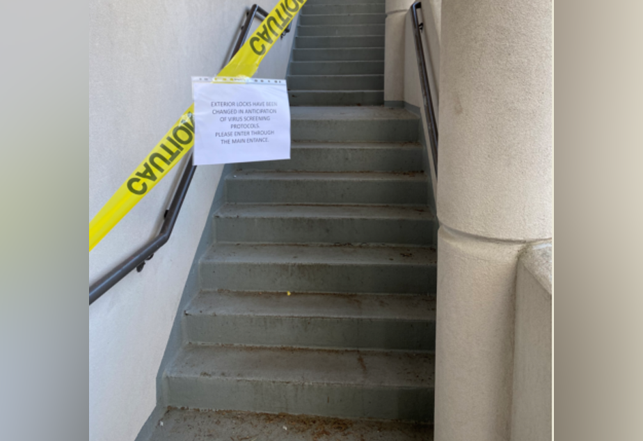 caption: At Western State Hospital, entrances have been blocked off and locks changed to prevent employees from entering without being screened first for coronavirus symptoms.