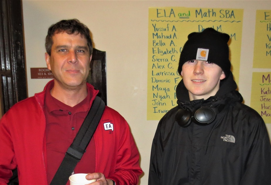 caption: The author, right, with his teacher, Shawn Kamp.