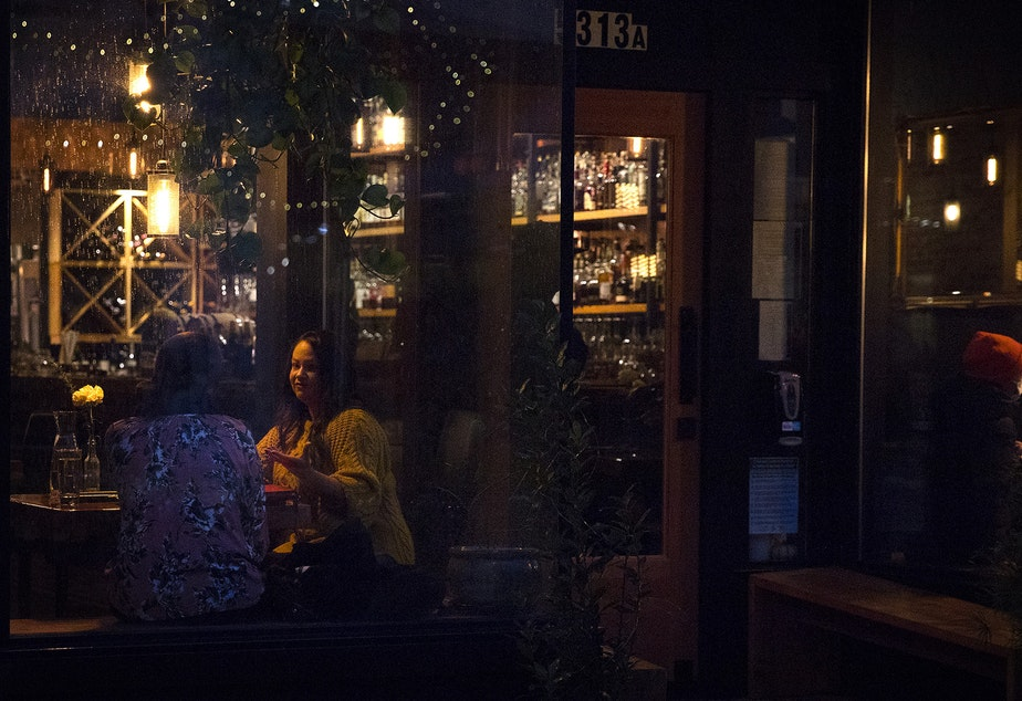 caption: Guests are shown dining inside of Gracia on Monday, November 16, 2020, along Ballard Avenue Northwest in Seattle. New statewide restrictions, including a ban on indoor dining beginning Wednesday, were announced by Gov. Jay Inslee on Sunday to curb the rapid spread of Covid-19.