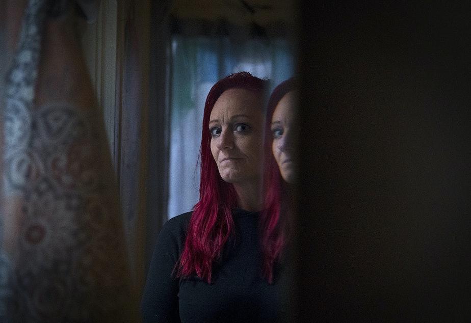 caption: Robin Curtis in her room at a downtown Seattle shelter on Friday, November 15, 2019. Curtis was attacked by a serial rapist two years ago. She testified against him in court this fall.