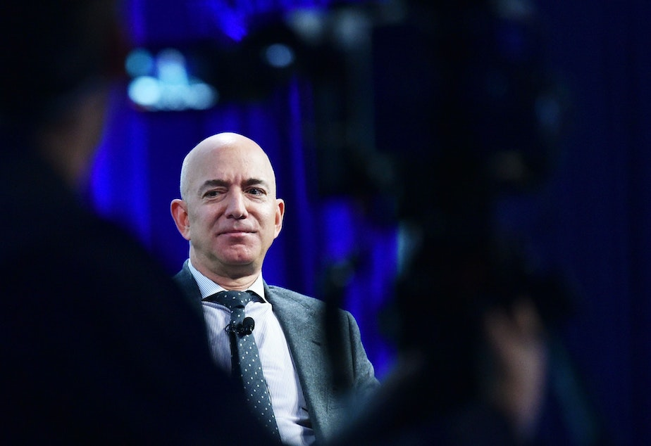 """caption: """"A next step in protecting our employees might be regular testing of all Amazonians, including those showing no symptoms,"""" Amazon CEO Bezos wrote on Thursday."""