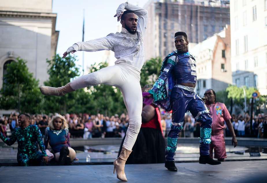 "caption: Performers compete during the ""Battle of the Legends"" vogueing competition outside of the Metropolitan Museum of Art on June 11, 2019 in New York City. (Johannes Eisele/AFP via Getty Images)"
