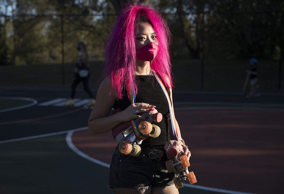 caption: Naima Pai, co-founder of Seattle Skates, stands for a portrait on Tuesday, October 6, 2020, during a decades themed skate meet up at the White Center Bicycle Playground in Seattle.