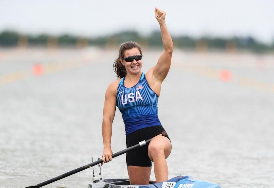 caption: Nevin Harrison celebrates her win at the ICF Sprint Canoe World Cup final in Szeged, Hungary, on May 15, 2021.