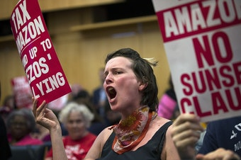 Emily McArthur reacts on Monday, May 14, 2018, during the head tax vote at City Hall in Seattle. Tap or click on the first image to see more.