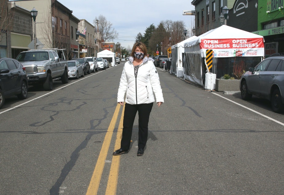 caption: Gaila Haas (Gutierrez) runs the Kent Downtown Partnership, which worked with the City of Kent to get outdoor dining structures built for restaurants in its downtown core. While protected from elements on 3 sides, they are open on the sidewalk side, in order to maintain good airflow during the pandemic.