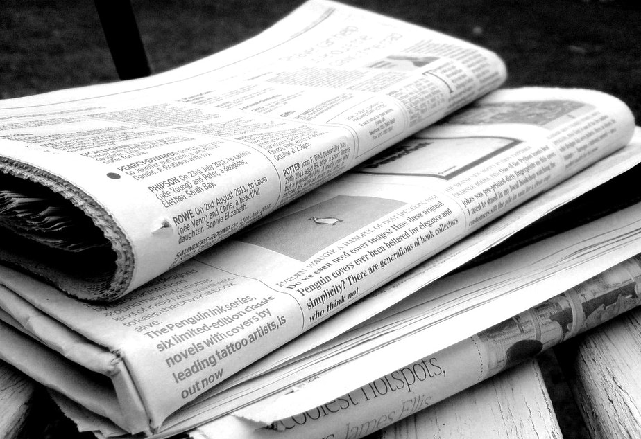 caption: Newspapers in black and white