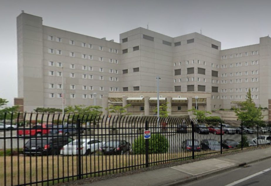 caption: The SeaTac Federal Detention Center, which publicly reports 287 cases of Covid-19 among detainees and staff since the pandemic started, has come under scrutiny for its handling of the disease.