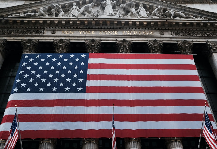 caption: Stocks fell again Monday as U.S. lawmakers continued to work on a massive stimulus measure. The floor of the New York Stock Exchange was closed as the exchange shifted to all-electronic trading amid the coronavirus outbreak.