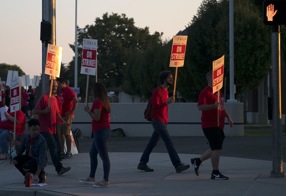 Teachers on strike march outside of Foster High School on Tuesday, September 5, 2018, in Tukwila.