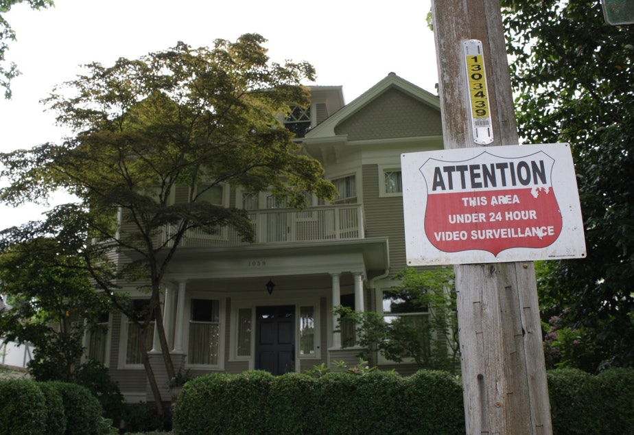 A sign in front of this Seattle house warns of 24 hour video surveillance.