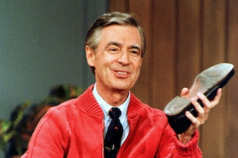 "FILE - This June 28, 1989, file photo, shows Fred Rogers as he rehearses the opening of his PBS show ""Mister Rogers' Neighborhood"" during a taping in Pittsburgh."