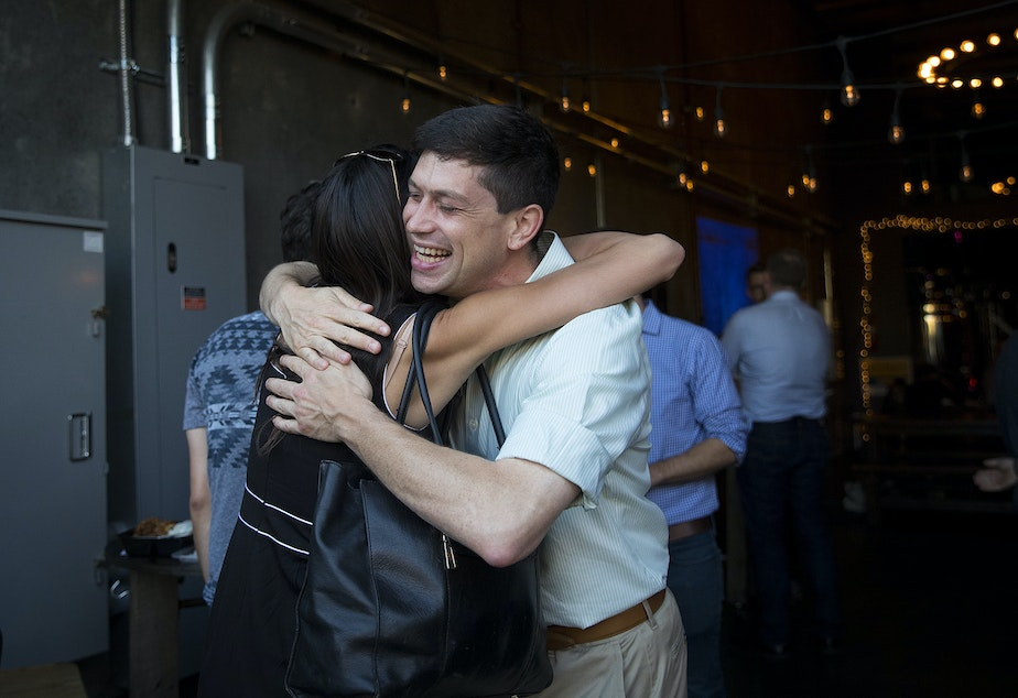 Seattle city council candidate in District 6 Dan Strauss hugs friend and supporter Michelle Nance during a primary election night party on Tuesday, August 6, 2019, at Obec Brewing in Seattle.