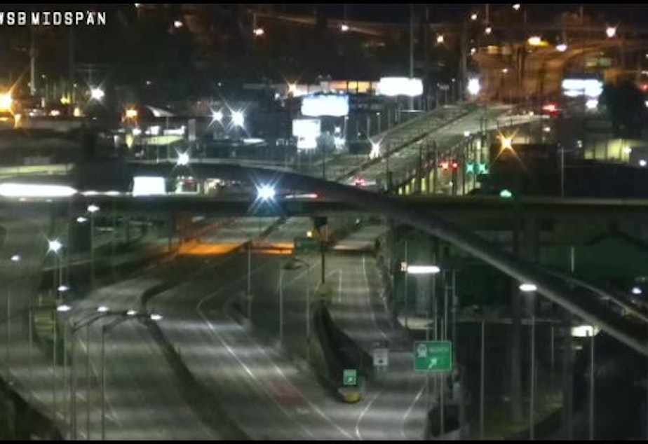 caption: A traffic camera shows the West Seattle Bridge devoid of traffic in March.