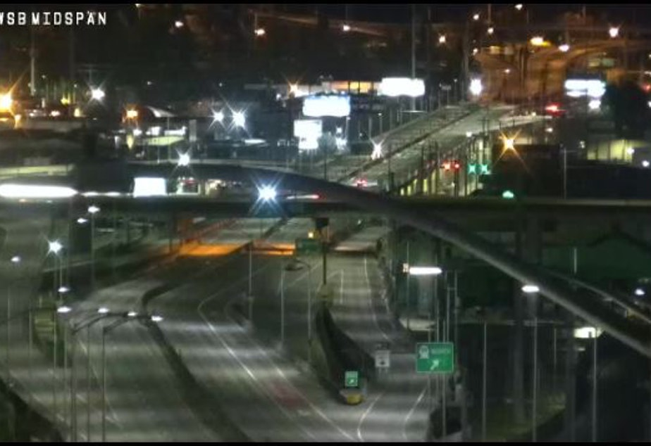 caption: A traffic camera shows the West Seattle Bridge devoid of traffic on Wednesday evening.