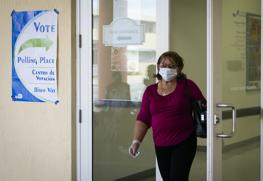 caption: A woman wearing mask and protective gloves leaves after cast her vote during the Florida Democratic primary election in Miami, Florida, on March 17, 2020. The latest Senate coronavirus relief bill includes $400 million to states to ensure upcoming elections are safe for voters and pollworkers.