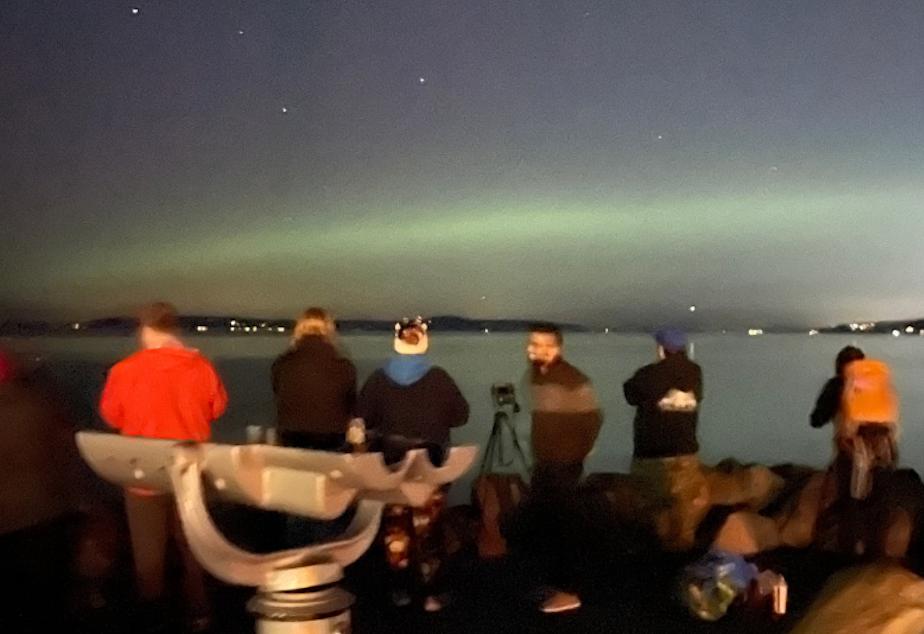caption: The northern lights seen over Edmonds, Wash. Monday, October 12, 2021.