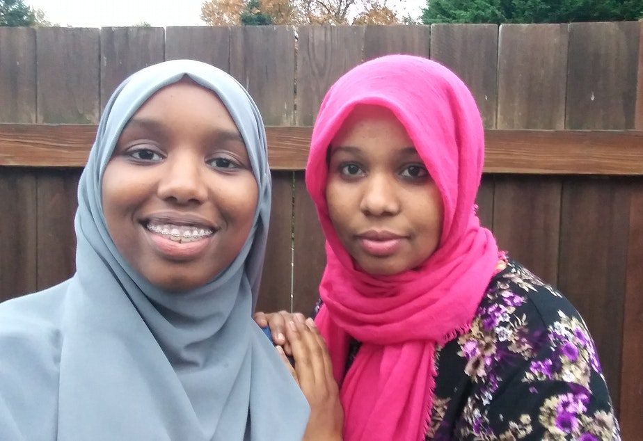 caption: RadioActive youth producer Marian Mohamed (left) with her mother, Mulki. Mulki was in the same refugee camp as Representative Ilhan Omar.