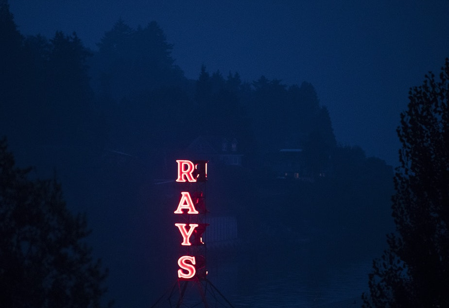 caption: A sign at Ray's Boathouse lights up on Friday, September 11, 2020, as smoke from wildfires burning in Oregon and California clouds the air, in Seattle.