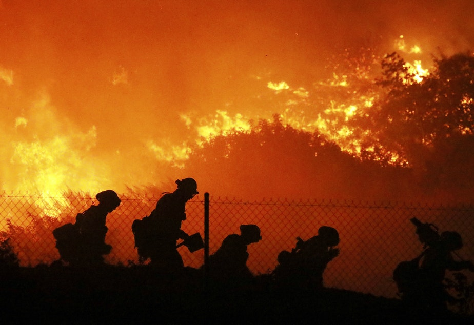 caption: The Trump administration has formally notified the United Nations that it is withdrawing from the Paris climate agreement. The move comes as climate change drives more frequent and severe wildfires, hurricanes and other hazards.