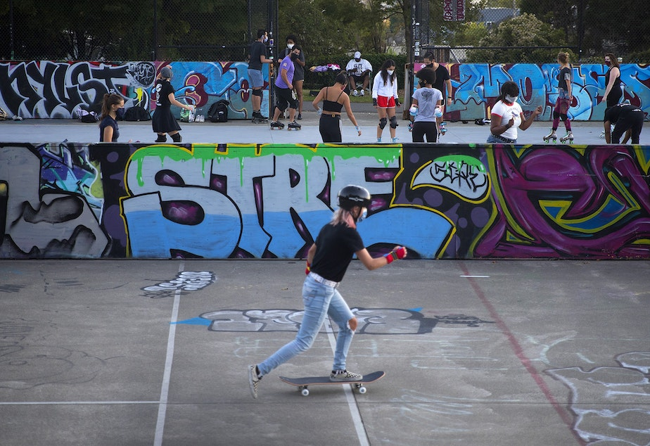 caption: A Roll Around Seatown skate meet up takes place on Monday, September 28, 2020, at the Judkins Park sports courts in Seattle.