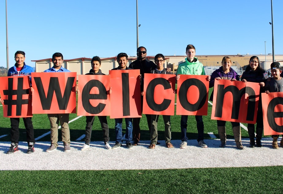 caption: Students at Tukwila's Foster High School recently posed for this photo to welcome new refugees.