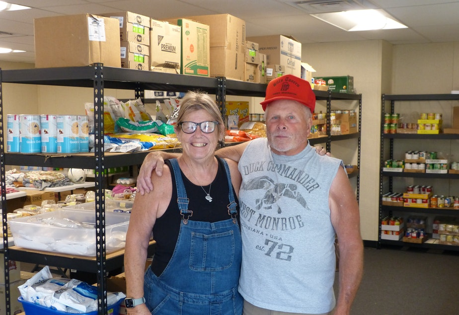 Two Malden residents, Laurie (on left) Bob Law (right), in the food bank