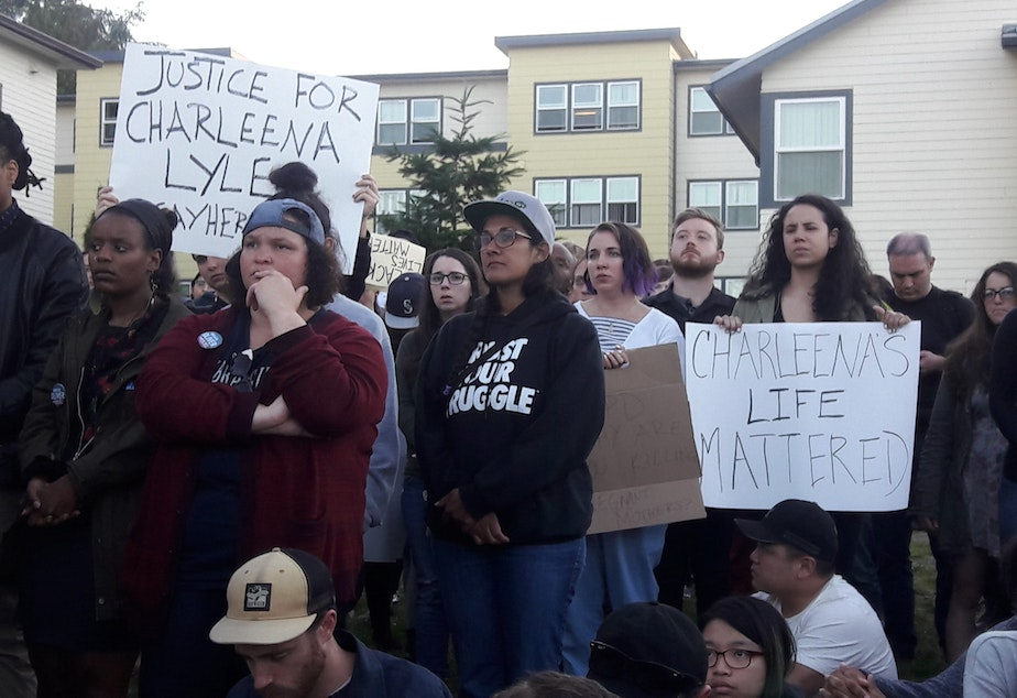 caption: Dozens gathered for a vigil held for a woman shot by Seattle Police