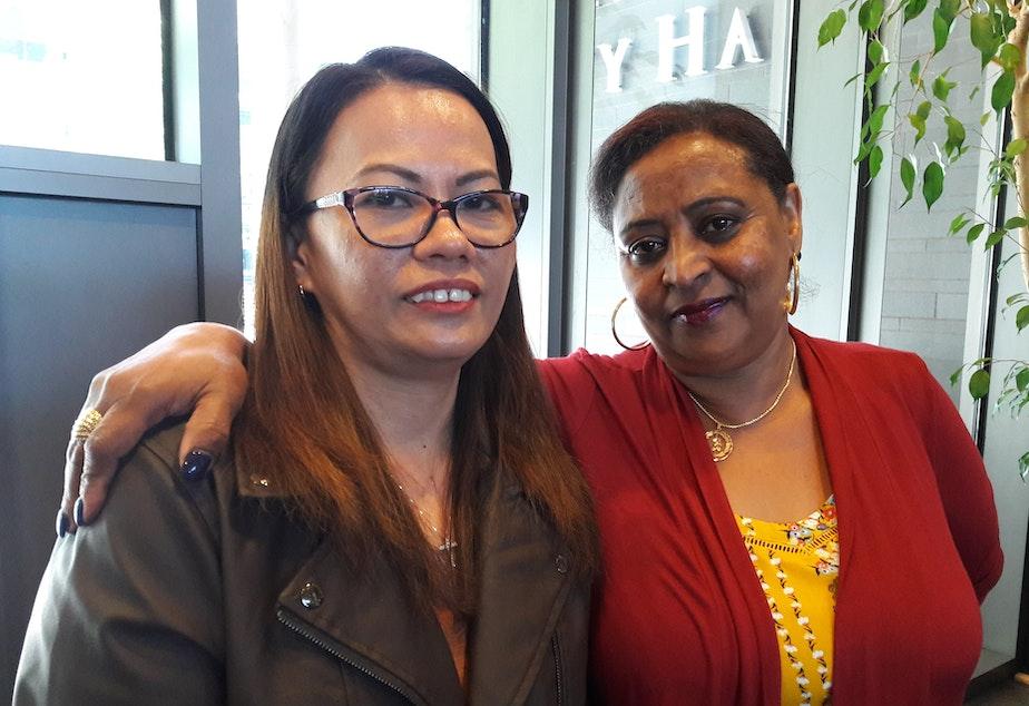 caption: Hotel workers Liza Cruz, left and Lula Haile, right.