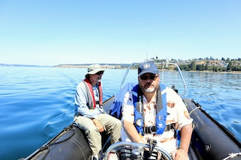 """Shipwreck hunters Jeff Groth, right, and Scott Williams methodically towed a magnetometer back and forth over a search grid -- """"mowing the lawn,"""" as they called it."""