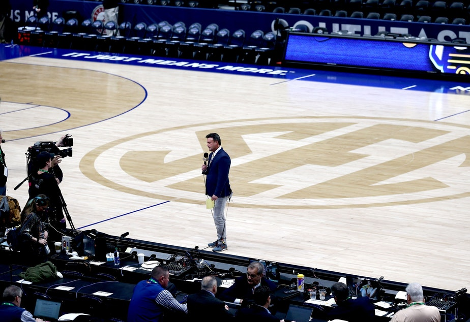 caption: ESPN's Karl Ravech reports on the cancellation of the SEC Men's Basketball Tournament on March 12, in Nashville. With no live sports to show, the network is scrambling to fill the time. Its offerings now include diversions like cherry pit spitting and marble racing.