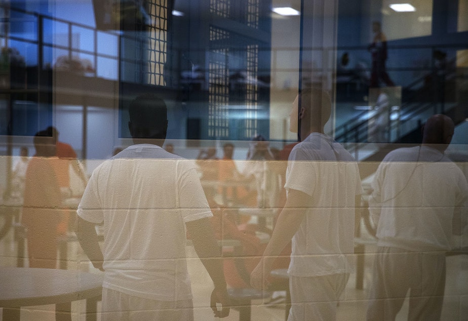 caption: Male detainees are shown in one of the housing units on Tuesday, September 10, 2019, at the Northwest Detention Center, recently renamed the Northwest ICE Processing Center, in Tacoma.