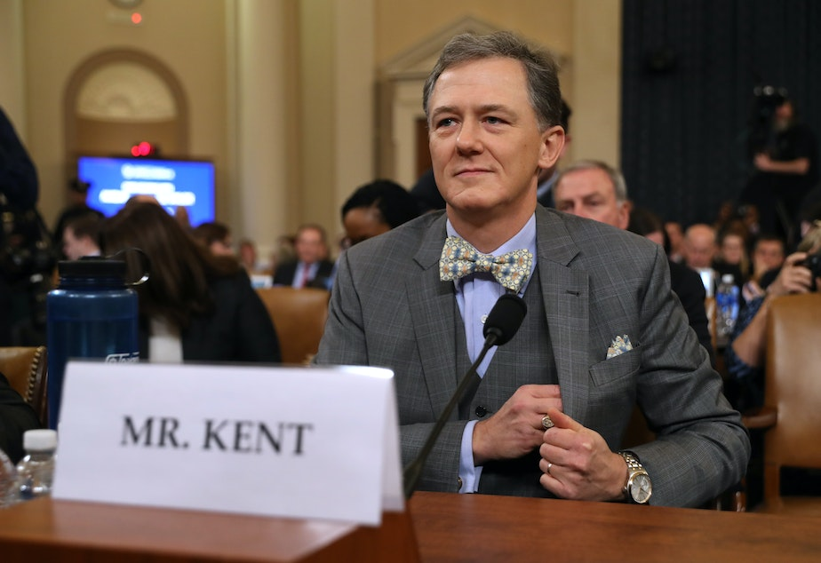 caption: Deputy Assistant Secretary for European and Eurasian Affairs George Kent waits to testify before the House Intelligence Committee on Capitol Hill on Wednesday.