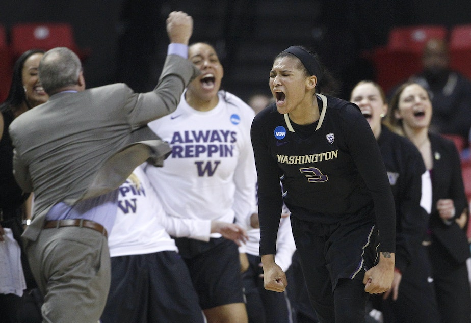 caption: Washington forward Talia Walton reacts after hitting a three-pointer in the second half of an NCAA college basketball game against Maryland in the second round of the NCAA tournament, Monday, March 21, 2016.