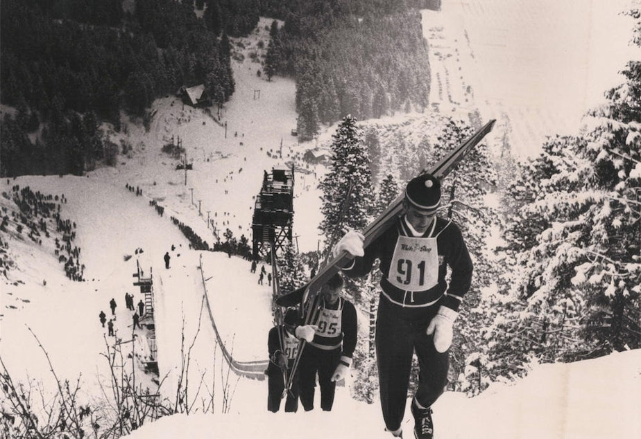 caption: In the heyday of ski jumping at the Leavenworth Ski Hill, competitors climbed a walkway to the top of the large ski jump.
