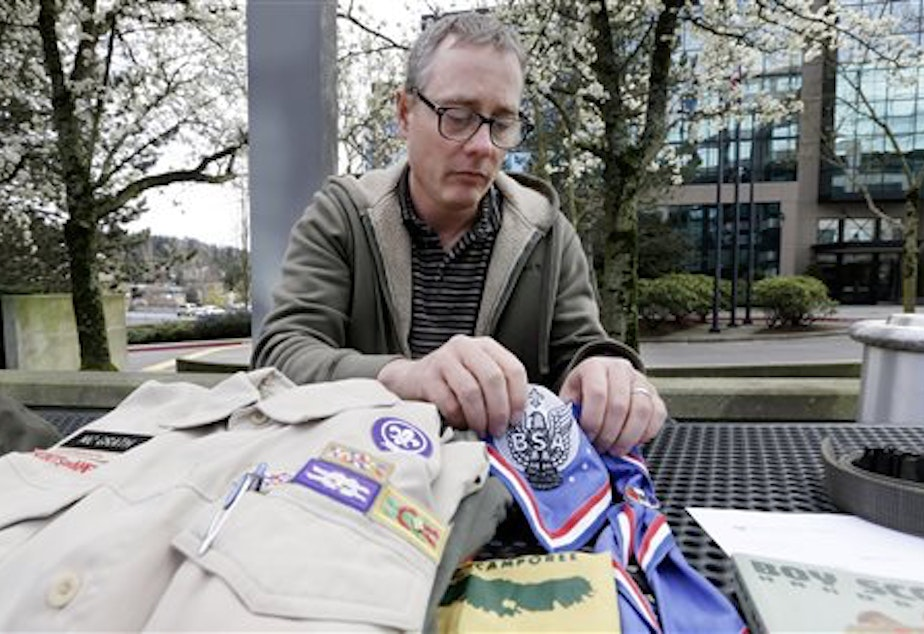 The Boys Scouts of America has revoked the charter of a Seattle church because it allowed a gay adult, Geoff McGrath, to continue leading a troop. McGrath, pictured here on April 1, 2014, has been leading Seattle Troop 98 since its application was approved last fall.