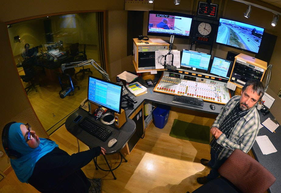 'The Record' producer Amina Al-Sadi and announcer Bernard Ouellette in the KUOW control room.