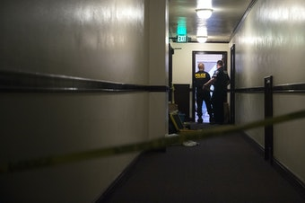 Police investigate the scene where two women were found dead on Monday, September 4, 2018, at the Malloy Apartments near the intersection of Northeast 43rd Street and 15th Avenue Northeast in Seattle.