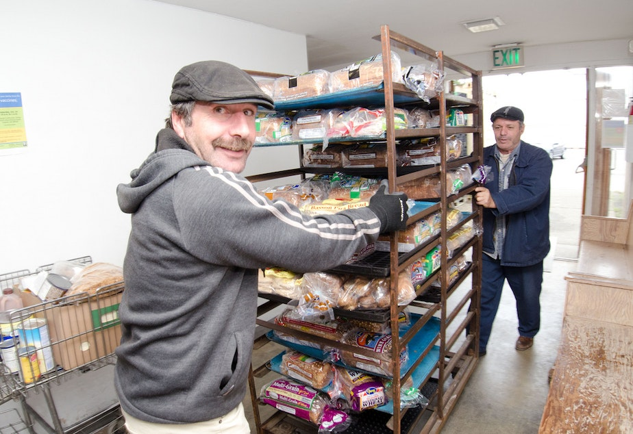 File photo. Volunteers cart bread into the Tukwila Pantry.