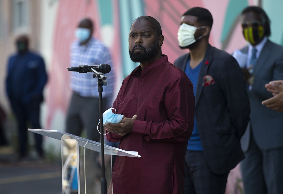 caption: Andre Taylor speaks to the crowd during a vigil to recognize the senseless killing of African American men and women outside of the First African Methodist Episcopal Church on Monday, June 1, 2020, in Seattle.
