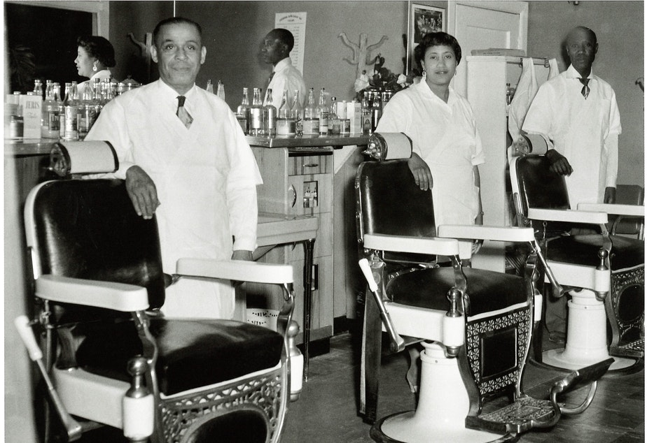 Bertha M Johnson, owner of Bertha's Barber Shop on 23rd Avenue, center, with two male barbers. Many of the cosmetologists in Seattle's Central District were trained at Marie Edwards School of Beauty on Jackson Street, which was the only African American-owned beauty school in the Pacific Northwest. (To help us ID the two male barbers, note the photo number. This is #5.)