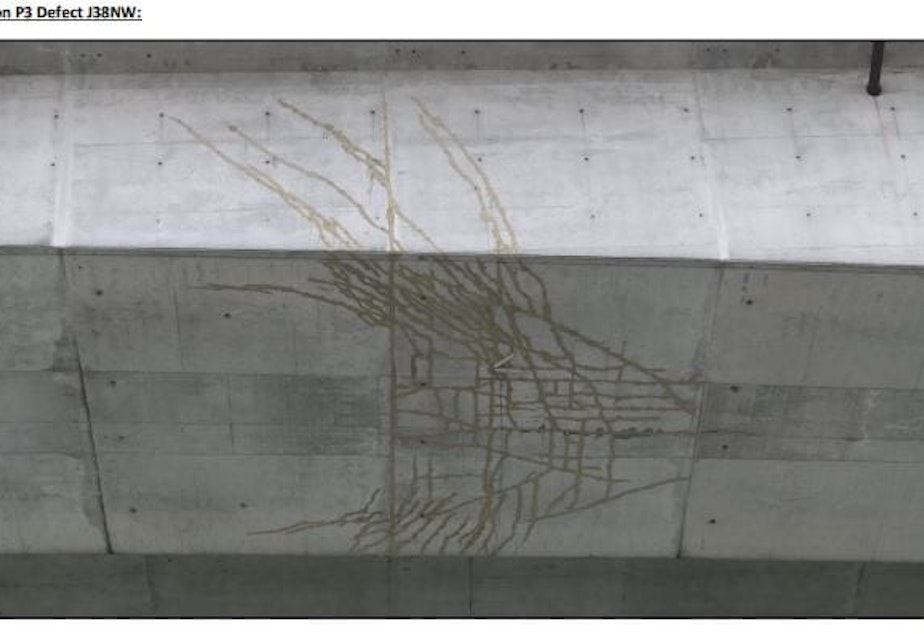 caption: A network of cracks on the underside of the West Seattle Bridge