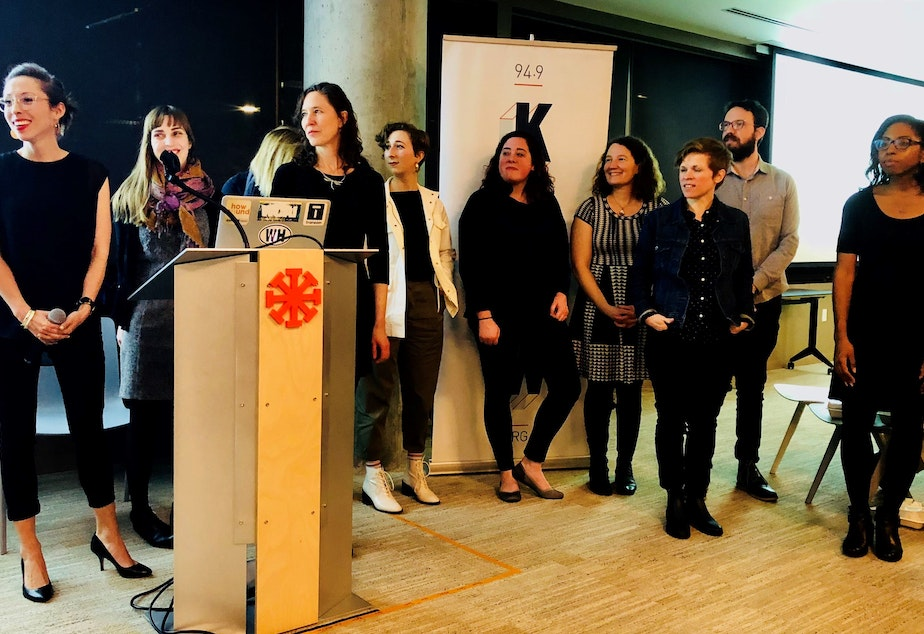 Transom Traveling Workshop producers, Seattle 2019 cohort. From left to right: Kristin Leong, Molly Smith, Rachel Robertson, Erin Conway-Smith (face hidden), Sam Leeds, Rachel Lerman, Michelle Wallar Martin, Dacia Clay, David Fleit and April Simpson