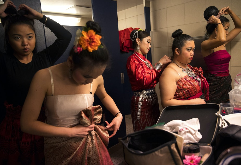 Members of the Thai Dance Team get ready before performing during the Lunar New Year celebration on Sunday, Feb. 11, 2018, in the Chinatown-International District in Seattle.
